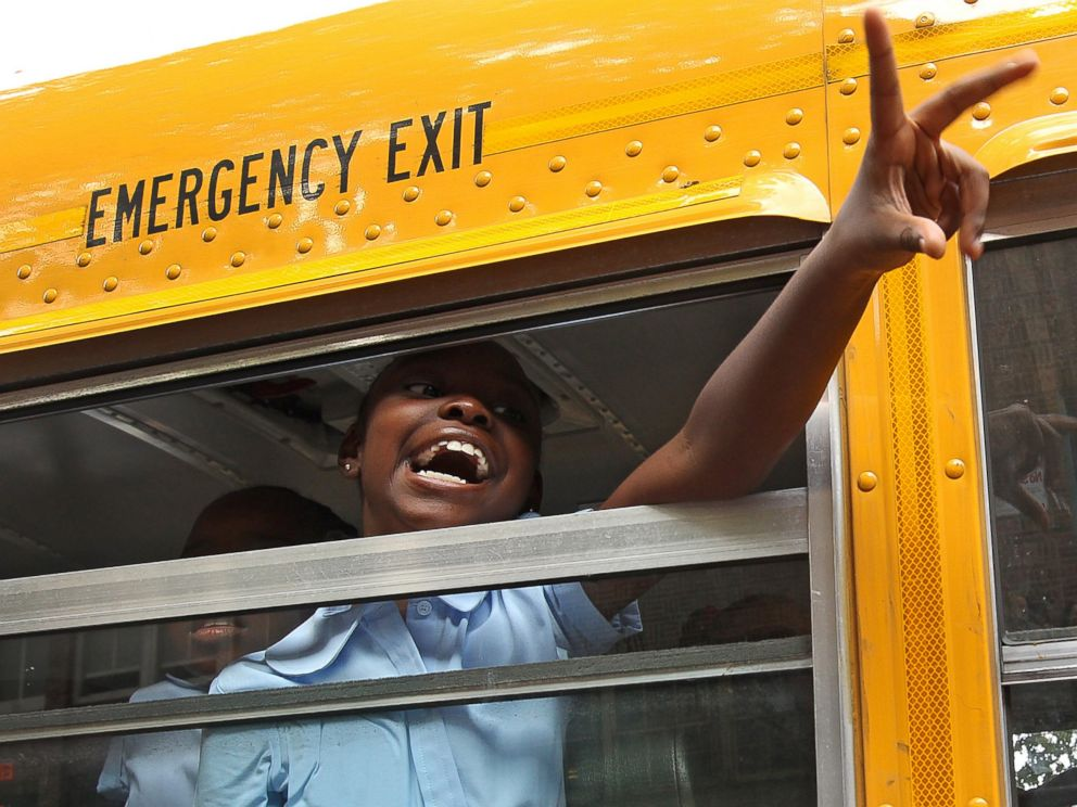 PHOTO: A third grade student arrives by bus on the first day of school at Ellis Elementary in Boston, Mass. on Sept. 5, 2012.