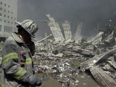 PHOTO: Firefighter walks through the rubble of the World Trade Center after it was struck by a commercial airliner in a terrorist attack.
