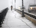 PHOTO: Snow made for a slippery commute on the Harvard Bridge over the Charles River, as a bicyclist rides down Massachusetts Avenue, Jan. 28, 2013.