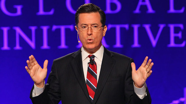 PHOTO: TV personality Stephen Colbert acknowledges the crowd at the Clinton Global Initiative University at Washington University on April 6, 2013 in St Louis.