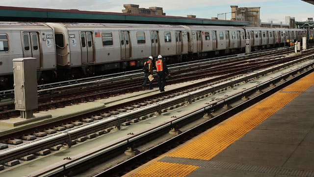 PHOTO: Metropolitan Transportation Authority workers walk the tracks two days after a man was pushed to his death in front of a train, Dec. 5, 2012 in New York City.