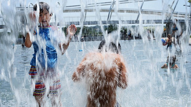 PHOTO: Ten-year-old Lilly Hwang-Geddes (L) of Ithaca, New York, plays in a fountain at the Yards Park July 5, 2012 in Washington, DC.