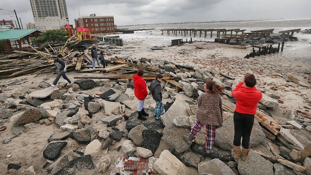 "PHOTO: People view the area where a 2000-foot section of the ""uptown"" boardwalk was destroyed by flooding from Hurricane Sandy, Oct. 30, 2012 in Atlantic City,"