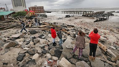 PHOTO: People view the area where a 2000-foot section of the uptown boardwalk was destroyed by flooding from Hurricane Sandy, Oct. 30, 2012 in Atlantic City,