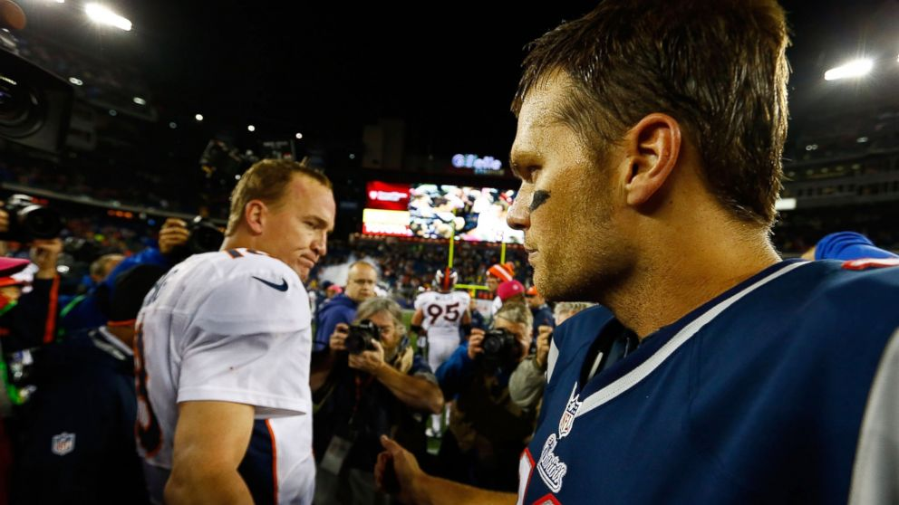 PHOTO: Tom Brady of the New England Patriots and Peyton Manning of the Denver Broncos greet each other at midfield following the game on October 7, 2012 at Gillette Stadium in Foxboro, Mass.