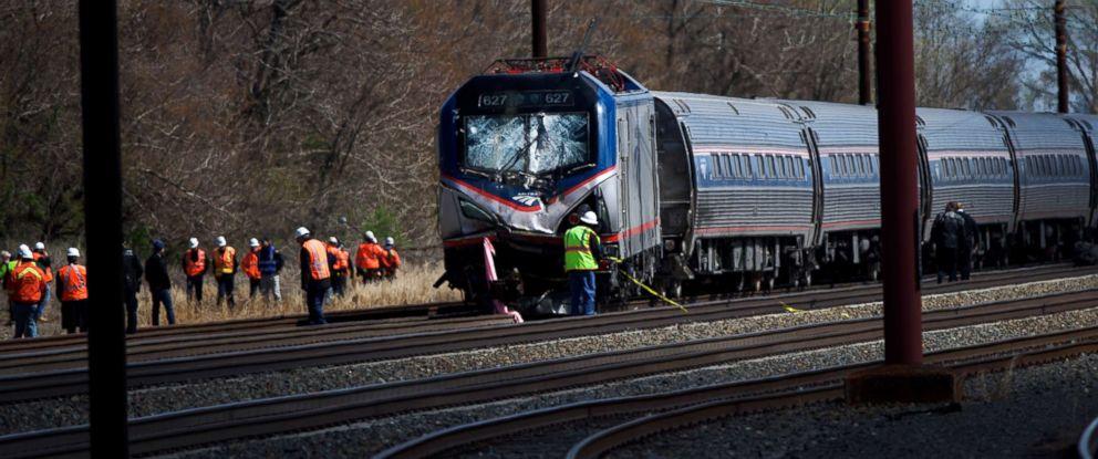 PHOTO: Emergency personnel investigate the crash site of Amtrak Palmetto train 89, April 3, 2016, in Chester, Pennsylvania.