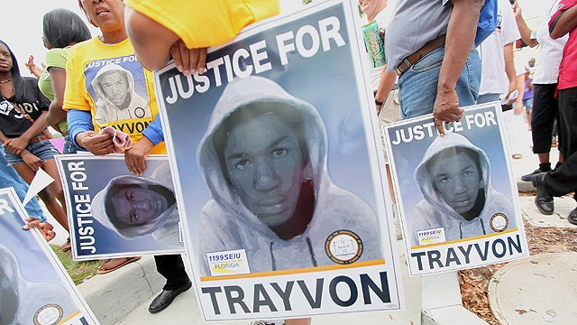 PHOTO: Trayvon Martin supporters march through the historically African American community of Goldsboro on their way to an NAACP rally in front of the Sanford Police Department on March 31, 2012 in Sanford, Florida.