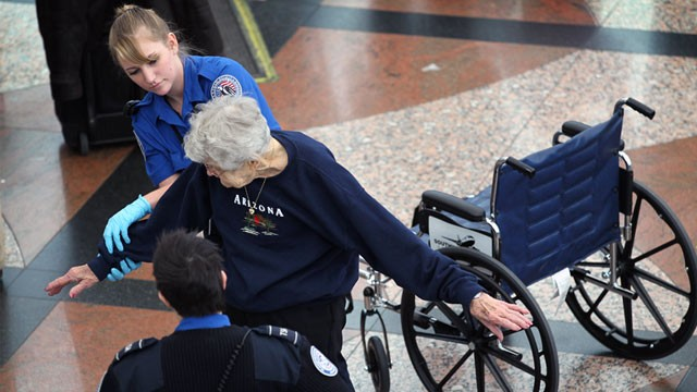 PHOTO: TSA agent performs enhanced pat down on elderly traveler