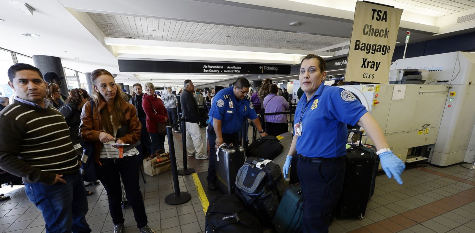PHOTO: Transportation Security Administration workers screen luggage in Terminal 2 of Los Angeles International Airport, Nov. 2, 2013.