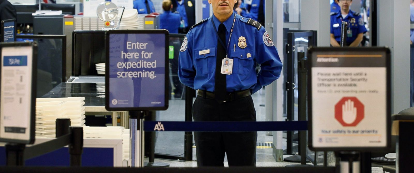 PHOTO: A TSA agent waits for passengers at Miami International Airport on Oct. 4, 2011, in Miami, Florida.
