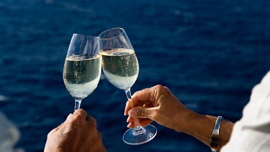 PHOTO: Two people are seen holding champagne glass on cruise ship in this undated photo.