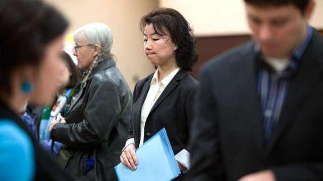 PHOTO: Graduate student Ali Adcock, center, waits in line to present herself to a potential employer at a job fair, Dec. 2, 2011 in Portland, Ore.