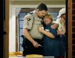 PHOTO: An unknown woman is consoled by a Sheriffs Deputy