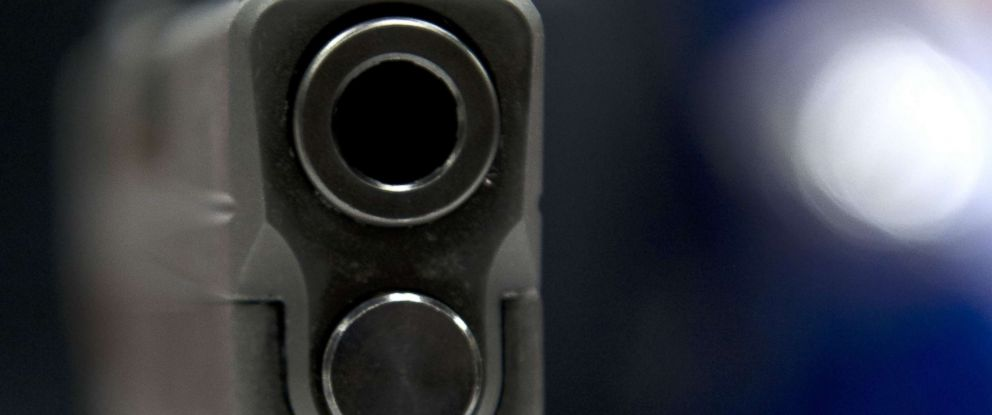 PHOTO: A view down the barrel of a semi-automatic handgun displayed at the143rd NRA Annual Meetings and Exhibits at the Indiana Convention Center in Indianapolis, Indiana, April 25, 2014.