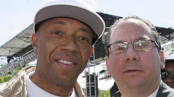 PHOTO: Russell Simmons (L) and Rabbi Marc Schneier (R) arrive at 'Save Darfur: Rally To Stop Genocide' April 30, 2006 in Washington, DC.