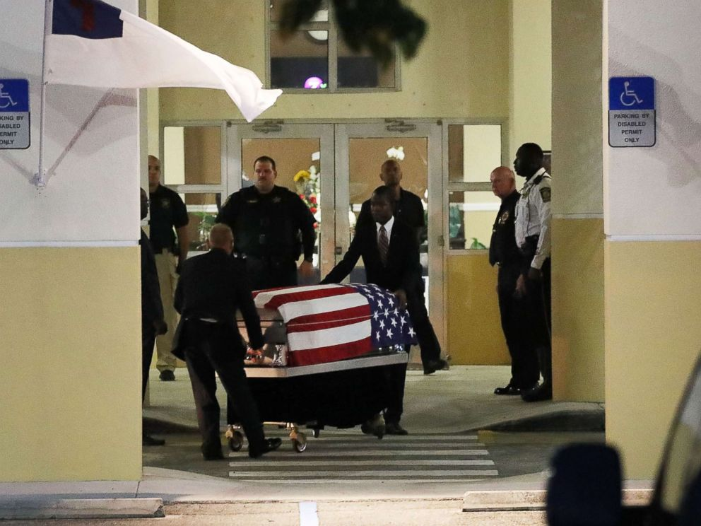 U.S. Army Sgt. La David Johnson is wheeled to the hearse after the viewing at the Christ the Rock Community Church