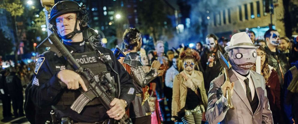 PHOTO: Heavily armed police guard as revelers march during the Greenwich Village Halloween Parade, Oct. 31, 2017, in New York City.