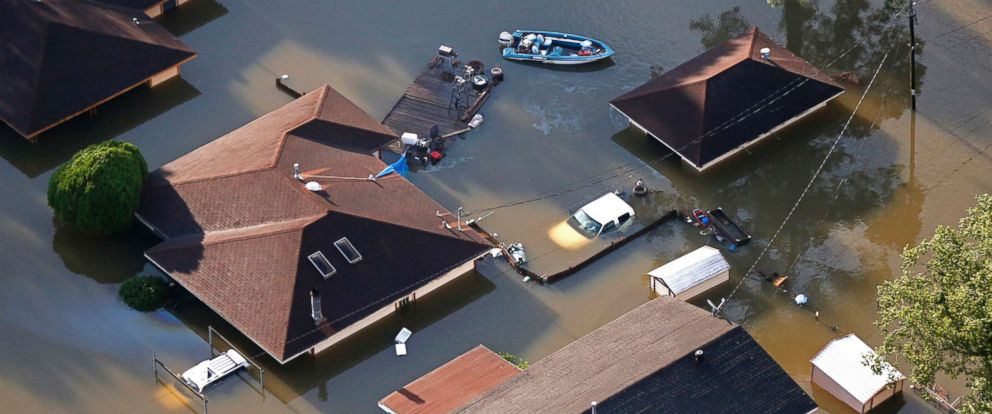 PHOTO: A boat sits near flooded homes in the aftermath of Tropical Storm Harvey in Beaumont, Texas, Aug. 31, 2017.