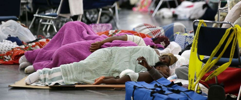 PHOTO: People sleep on the floor at the George R. Brown Convention Center that