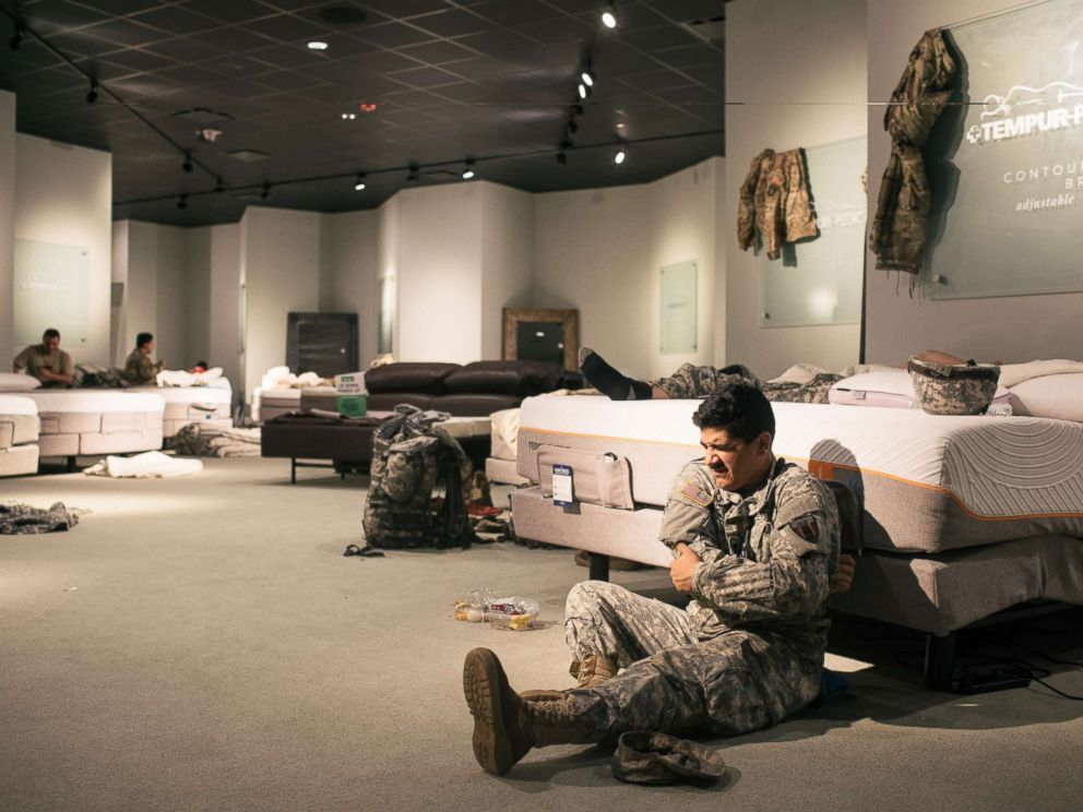 Amazing PHOTO: Members Of The National Guard Rest At A Gallery Furniture Store In  Richmond,