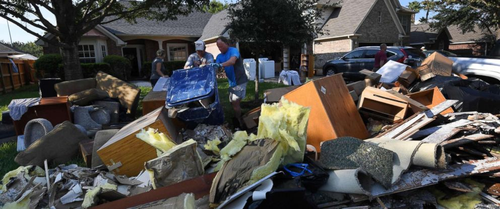 Nice Houston Christmas Tree Pickup Part - 7: PHOTO: Members Of The Olson Family Remove Debris And Damaged Items From  Their Fathers Home