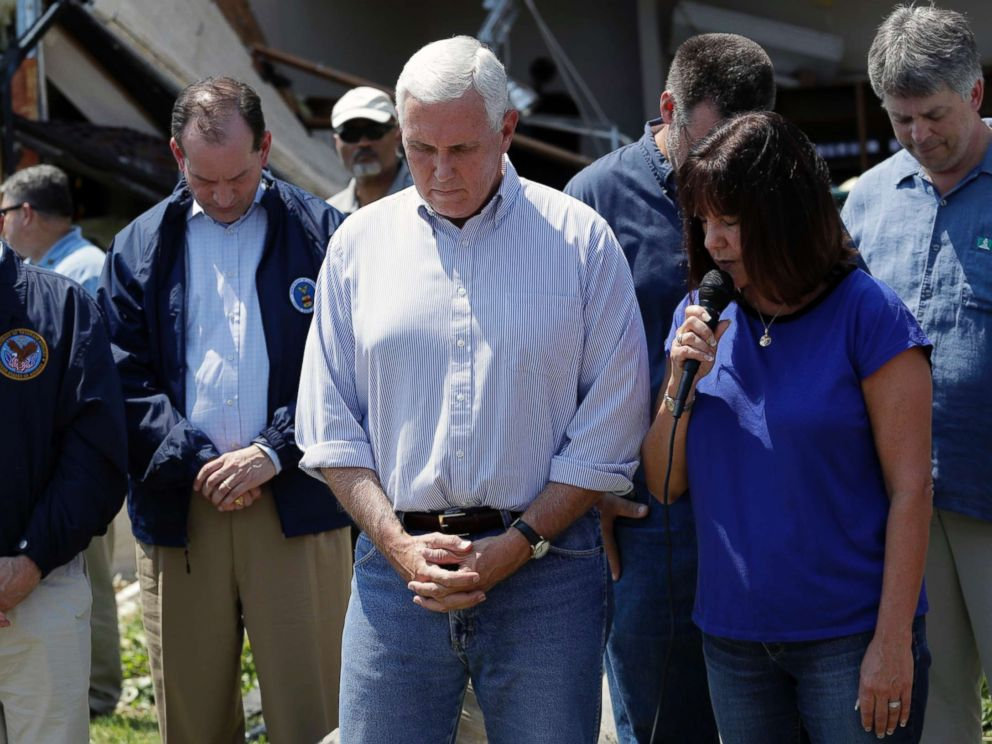 PHOTO: Vice President Mike Pence, center, and others bow their heads as his wife, Karen says a prayer during the couples visit to the First Baptist Church of Rockport, Aug. 31, 2017, in Rockport, Texas.