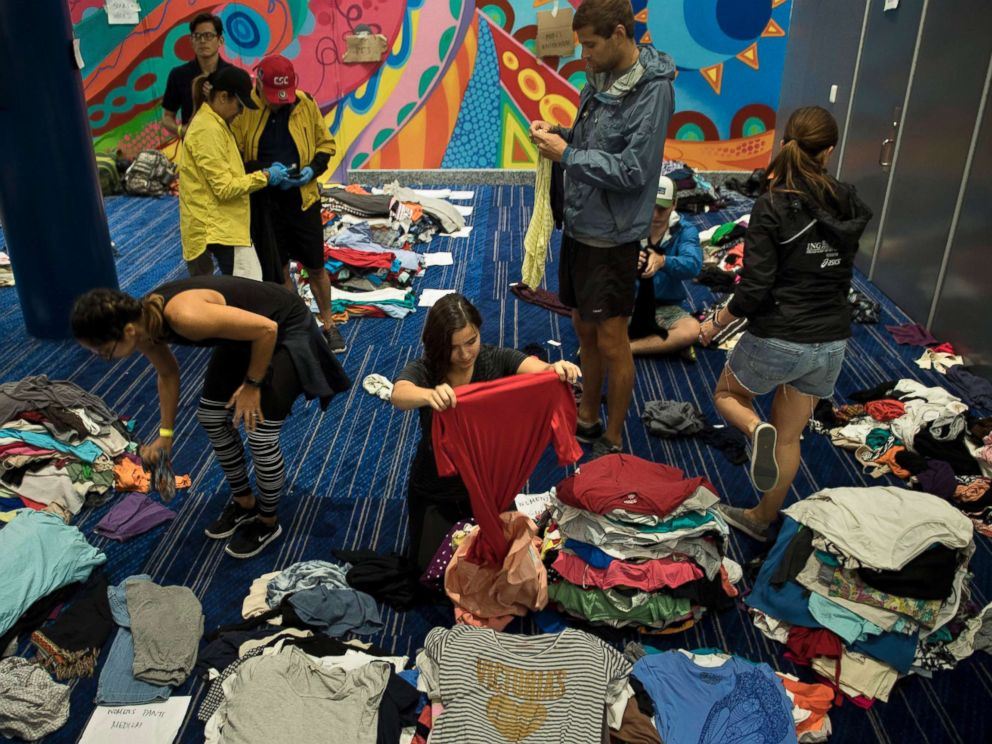 PHOTO: Volunteers sort through donated clothing at a shelter in the George R. Brown