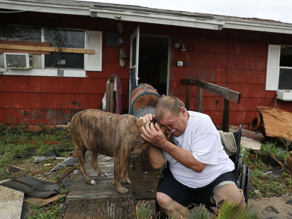 PHOTO: Steve Culver cries with his dog Otis as he talks about what he said