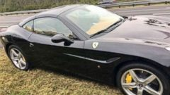 'Hilburn Hunkins, from Kissimmee, Fla., was pulled over driving this stolen $250,000 Ferrari on Dec. 28, 2017.' from the web at 'http://a.abcnews.com/images/US/ho-black-ferrari-stolen-mo-20171229_16x9t_240.jpg'