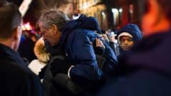 'New York City Mayor Bill de Blasio hugs a resident of the apartment building where 12 people died in the Bronx on Dec. 28, 2017.' from the web at 'http://a.abcnews.com/images/US/ho-deblasio-hug-fire-20171229_16x9t_240.jpg'