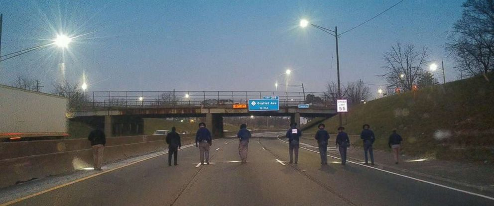 Michigan State Police comb I-94 for evidence Thursday morning after a series of shootings in the Detroit area.