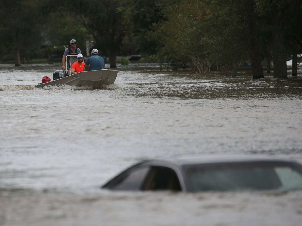 PHOTO: A rescue boat evacuates people from the rising waters of Buffalo Bayou following Hurricane Harvey in a neighborhood west of Houston, Texas, August 30, 2017.