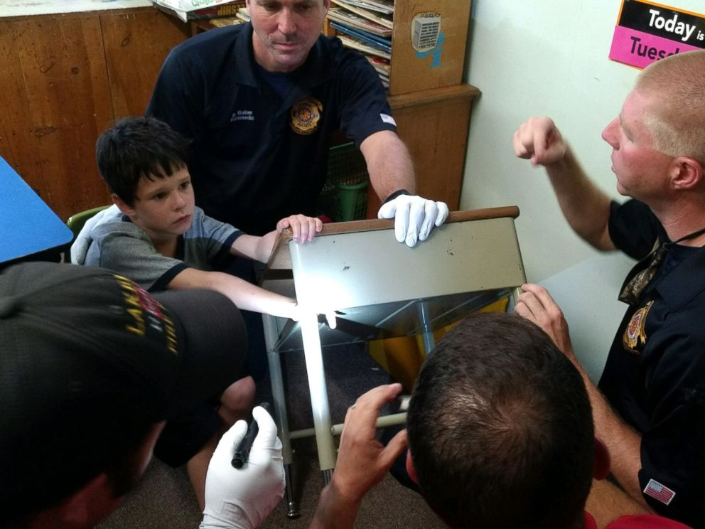 PHOTO: Lakeland Fire Department rescue crews worked patiently and kept Gio Aponte calm as they worked to free his finger from the desk, June 30, 2016.