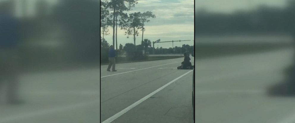 PHOTO: Video recently released by Florida authorities shows the moment a passerby in Fort Meyers shoots a man attacking a Lee County Sheriffs Deputy on Nov. 18.