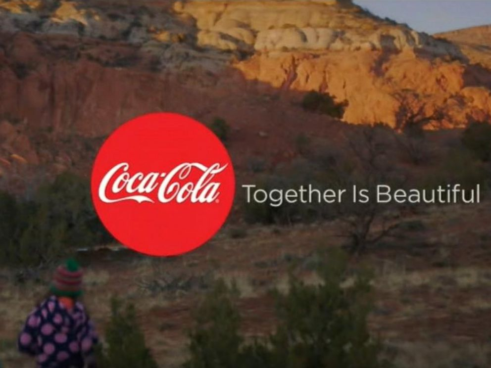 an examination of the america is beautiful coca cola advertisement Like most people (i think), i watch the super bowl mostly for the commercials this year, the first one to make me cry was a coca cola ad that featured america the beautiful being sung in several different languages.