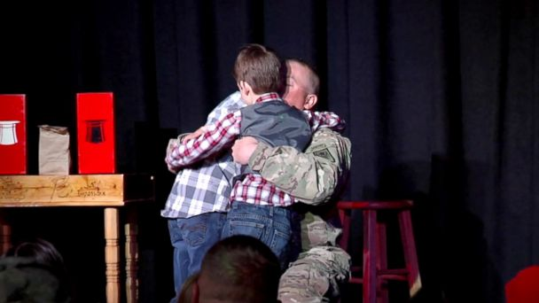 PHOTO: First Sergeant Benjamin Krainbrink surprised his sons at son Drake's tenth birthday party at Impossibles Magic Shop and Theatre on Feb. 25, 2017.