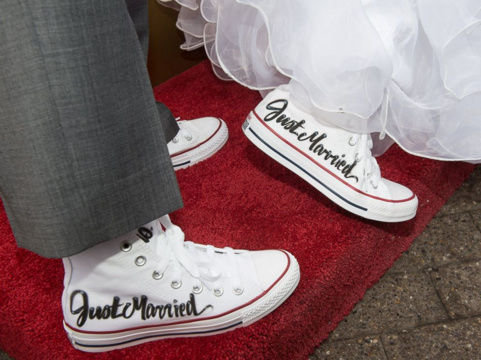 PHOTO: Krista Owens and Danielle Reno are photographed in matching sneakers during their wedding on the top of the Empire State Building in New York, Feb. 14, 2017.