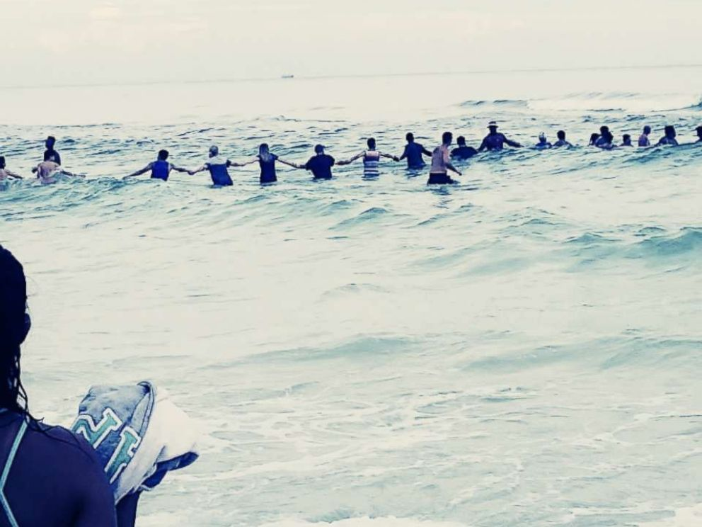 PHOTO: A group of strangers linked arms and waded into the ocean to rescue a group of swimmers stranded off the coast of Panama City Beach, Fla., July 8, 2017.