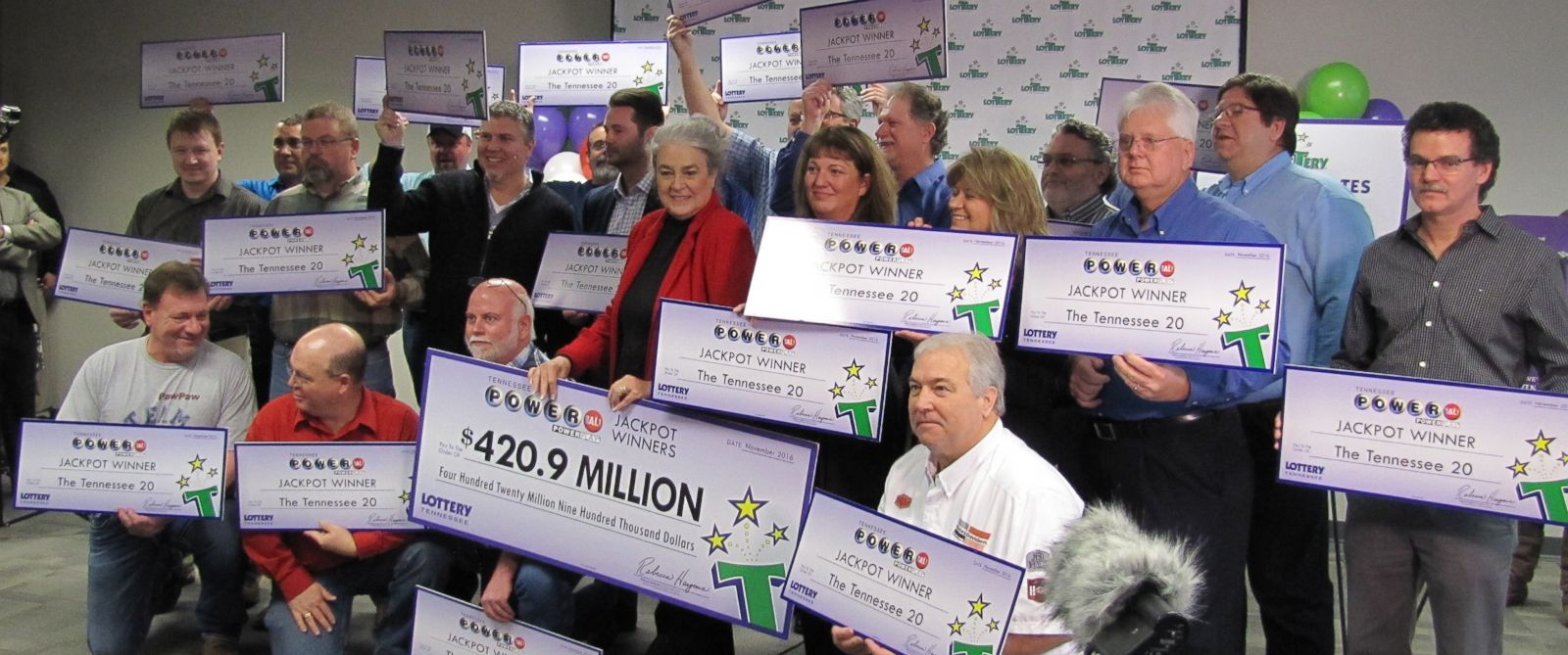"PHOTO: Members of the ""Tennessee 20"" are pictured on Nov. 29, 2016 after it was announced by the Tennessee Education Lottery that the group of co-workers would split a $420.9 Powerball jackpot."