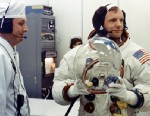PHOTO: Apollo 11 Commander Neil Armstrong prepares to put on his helmet with the assistance of a spacesuit technician during suiting operations in the Manned Spacecraft Operations Building (MSOB) prior to the astronauts departure to Launch Pad 39A.