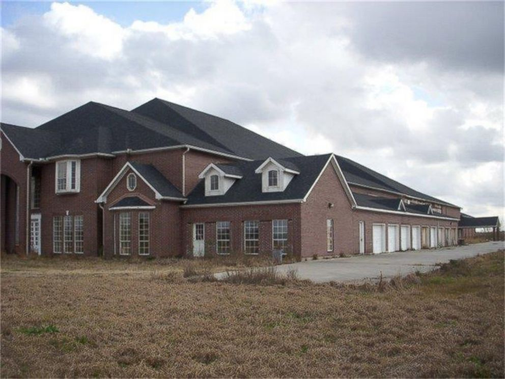 Everything 39 s bigger in texas 46 bedroom mansion hits the for Homes with big garages for sale