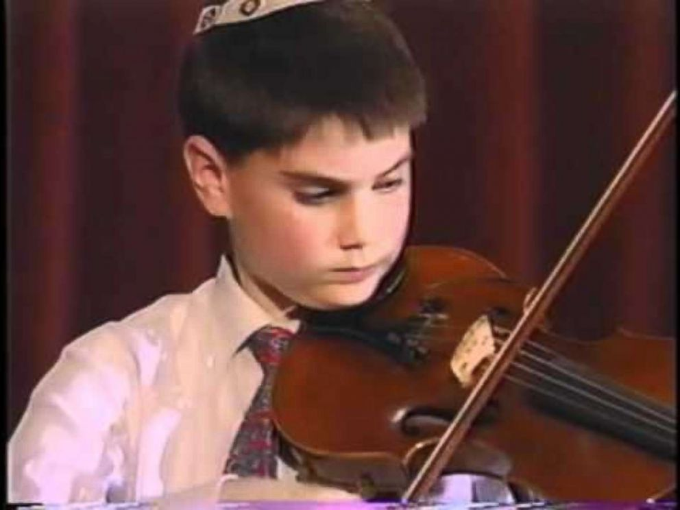 Ben Shapiro is seen here playing the violin as a child in this undated family photo.