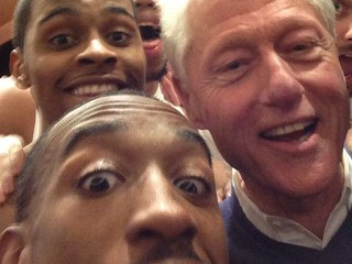 Clinton Celebrates Win with Team
