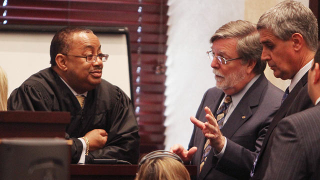 PHOTO: Judge Belvin Perry listens to defense attorney Cheney Mason, right, during a sidebar before the start of court in the Casey Anthony trial at the Orange County Courthouse in Orlando, Fla., June 20, 2011.