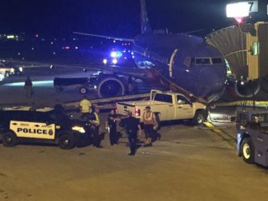 PHOTO: A Southwest Airlines aircraft sits at Eppley Airfield in Omaha, Nebraska, after a man rammed a pickup truck into its nose gear on August 25, 2016.
