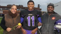 PHOTO: Aaron Dunigan with his mother and father at senior day.