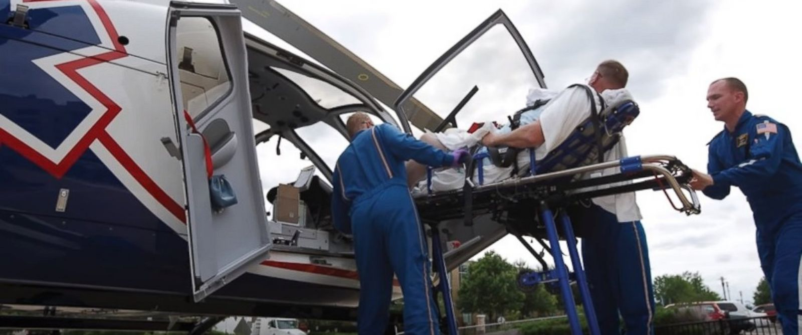 PHOTO: Air Methods employees transport a patient in this image from the Air Methods YouTube page.