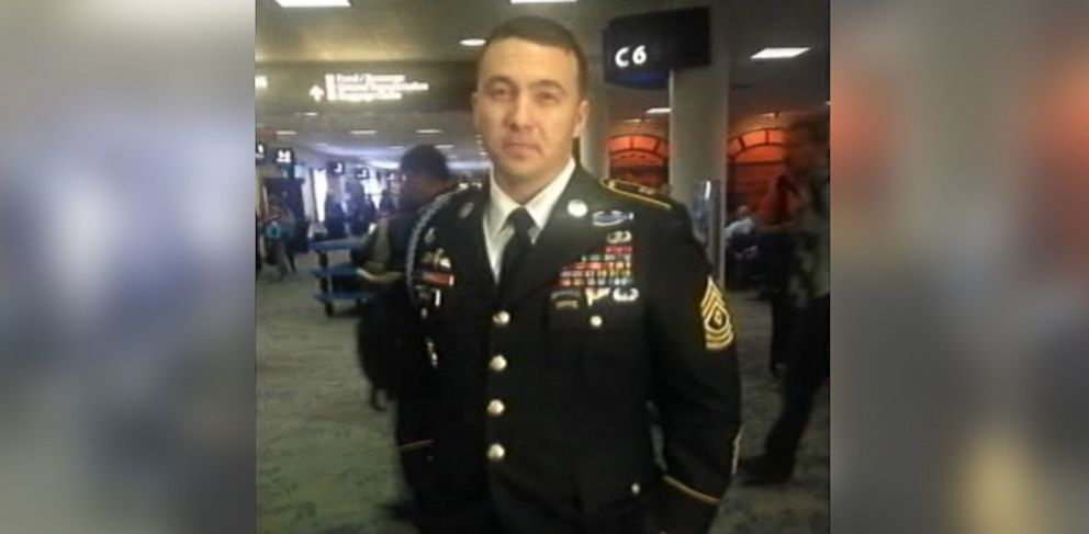 PHOTO: An Army Ranger on a flight from Portland Ore. to Charlotte, North Carolina was not allowed to hang up his uniform during the flight.