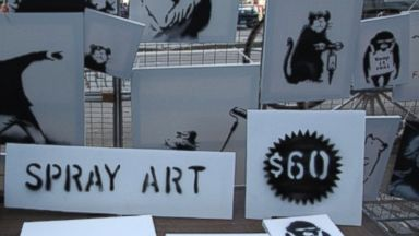 PHOTO: Banksy set up a one-time, pop-up stall on Fifth Ave. near Central Park where he sold his spray art for $60 apiece, Oct. 13, 2013.