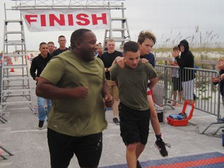 Marine Carries Fla. Boy Over Finish Line